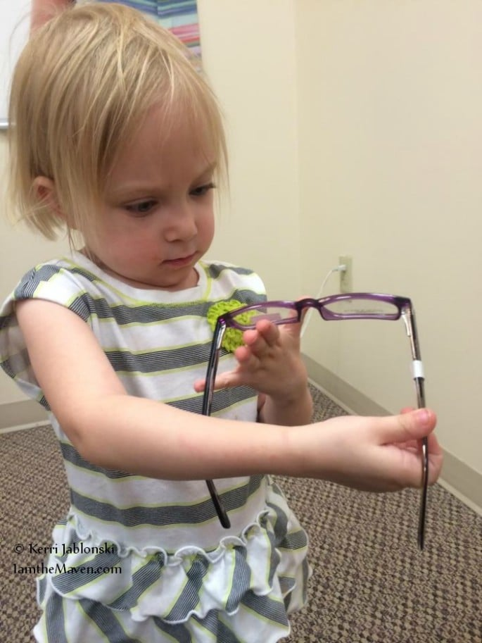 inspecting the purple glasses