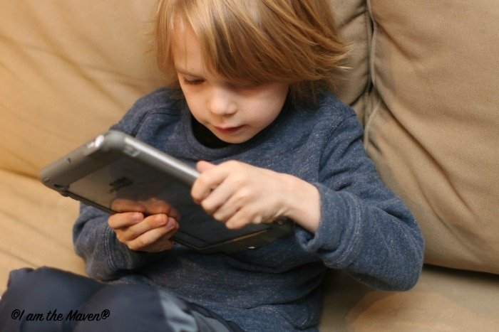Sometimes iPad time gets us through the morning #GNKroger #ad